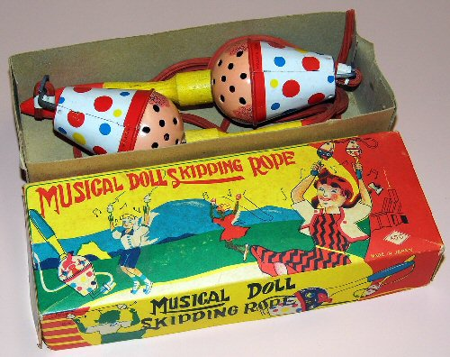 03bb 500 tin musical doll