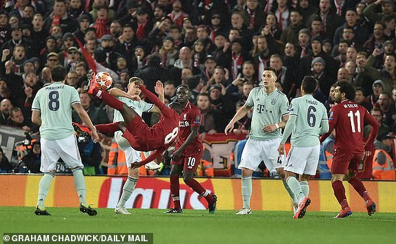 Naby Keita attempts an acrobatic kick for Liverpool during the game