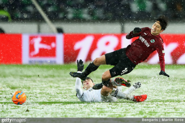 Hannover's Genki Haraguchi thought he'd scored against Leverkusen but was denied by the snow