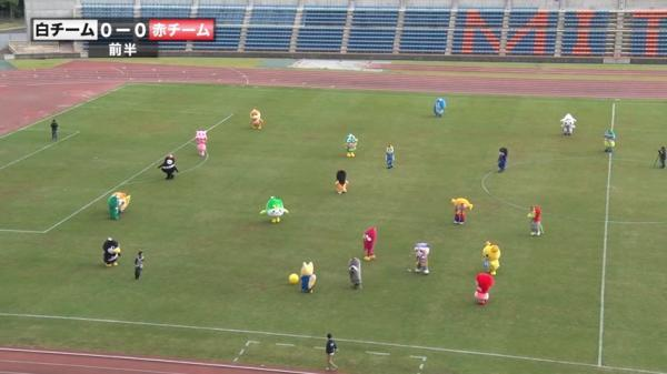 Japanese mascots playing soccer