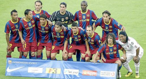 Ronaldinho of AC Milan joined his former Barcelona teammates after the Joan Gamper Trophy match
