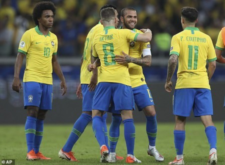 The Brazilian players congratulate each other after they keep a clean sheet against their rivals