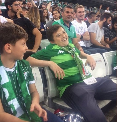 fan was actually a 36-year-old man and the child beside him was his son